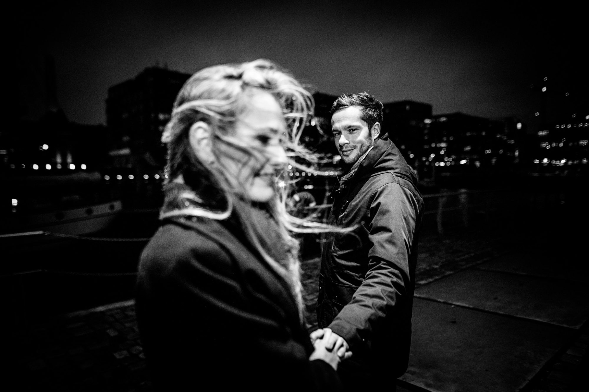 Emotional Couple in windy hamburg port